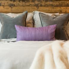 Purple and Gray Accents Add Color and Contrast to the Neutral, Rustic-Contemporary Bedroom