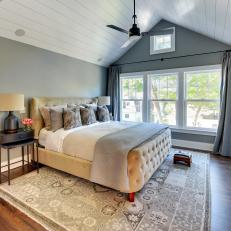 Vaulted White Shiplap Ceiling Helps Natural Light Move Throughout The Master Bedroom