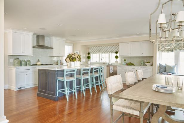 White Cottage Kitchen With Blue Barstools