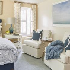 Neutral and Blue Transitional Bedroom With Glass Lamp