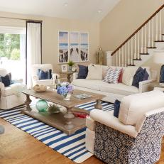 Blue and White Coastal Living Room With Striped Rug