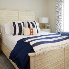 Neutral Coastal Bedroom With Striped Throw