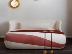 Graphic Cream and Pink Color Blocked Sofa with Bronze Cocktail Tables and Wall Art