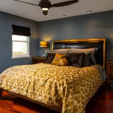 Gray Bedroom With Yellow Bed Linens