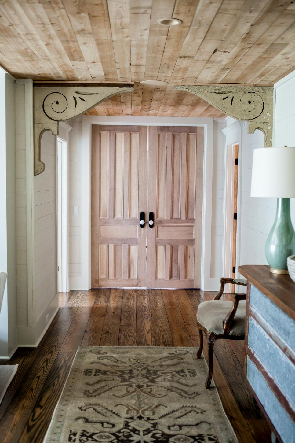 country-style entryway with reclaimed wood ceiling