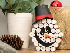 Fall into winter by turning those old corks into a decor piece that's both a pumpkin and snowman.