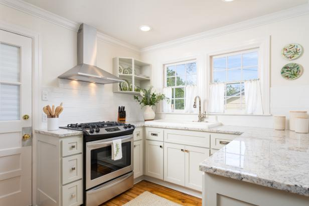 White Kitchen with Gray Marble Countertops, Cream Cabinets
