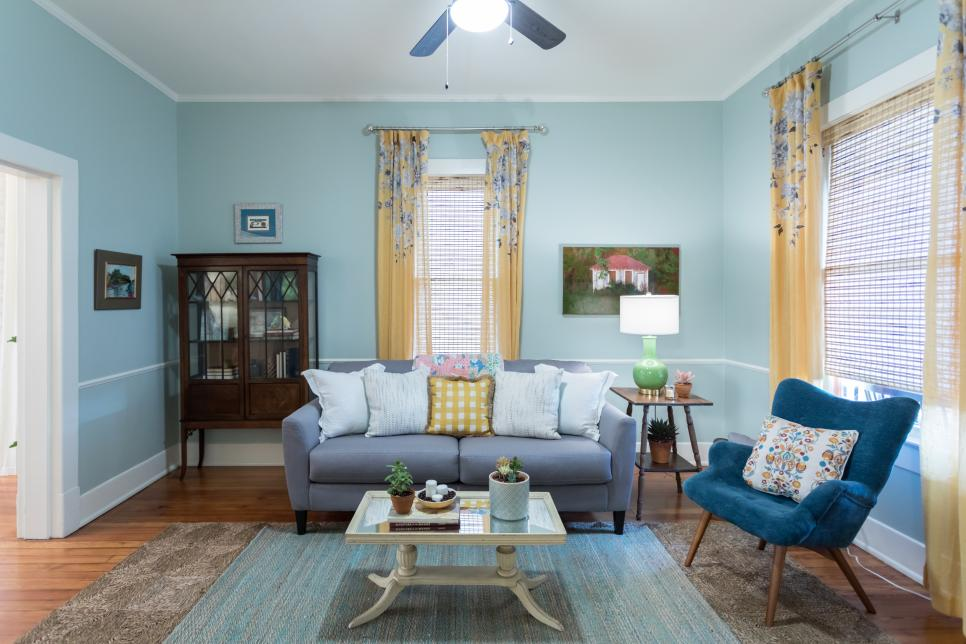 Blue Living Room with Yellow Floral Curtains, Blue Armchair and Rug