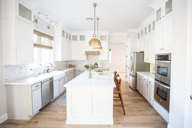 White Kitchen With Gold Pendants