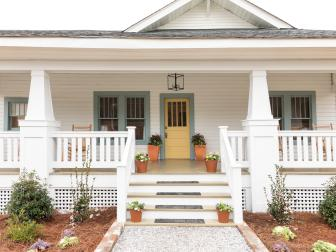 White Craftsman Home Exterior with Green Trim and Yellow Front Door