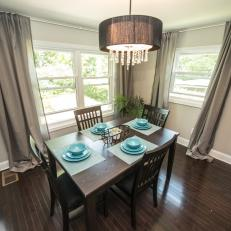 Contemporary Brown Dining Room with Gray Curtains