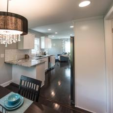 Contemporary White Open Plan Kitchen and Dining Room with Hardwood Brown Floor