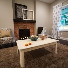 Contemporary Neutral Living Room with Brown Brick Fireplace