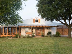 White Farmhouse Exterior with Neutral Screened Porch and Garage