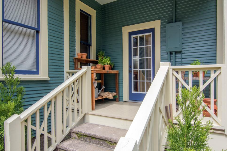 Blue Back Porch with White Stairs and Railing