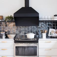 Modern Black and White Kitchen with Black Range Hood