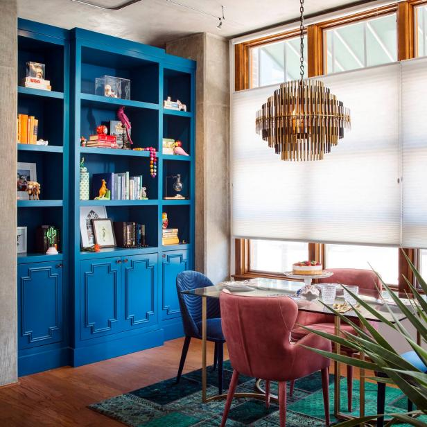 Eclectic Dining Room With Blue Bookshelf