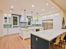White Contemporary Kitchen with Dual Islands, Bold Backsplash