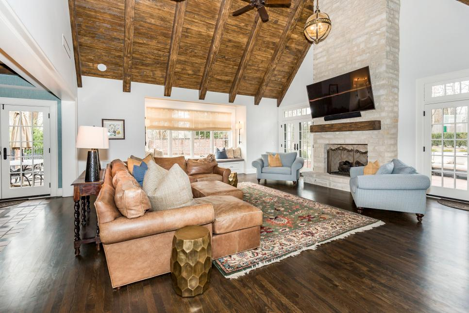 A mid-sized living room with wood floors and two story fireplace.
