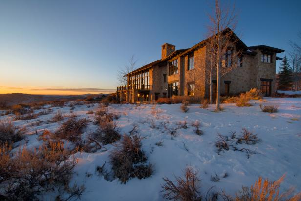 Mansion With Stone Exterior Overlooks Mountains in Colorado