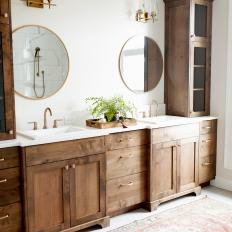 Storage Towers Add Warmth, Height and Dimension in Neutral Bathroom