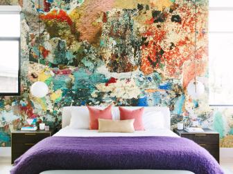 Master Bedroom With Multicolor Abstract Accent Wall And Colorful Modern Accessories