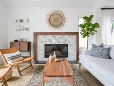 Transitional Living Room Features Unique Fireplace Surround