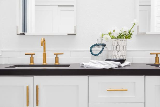 Gold-Colored Hardware and Faucet in Kitchen
