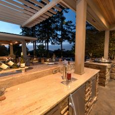 Contemporary Outdoor Kitchen And Covered Patio With Wood And Stone Details