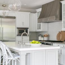 Contemporary White Kitchen With Work Island And Modern Appliances And Lighting