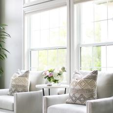 Contemporary White Living Room Detail With Arm Chairs And Side Table