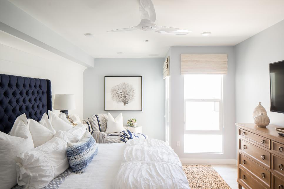 Blue And White Bedroom With Upholstered Headboard And Chaise