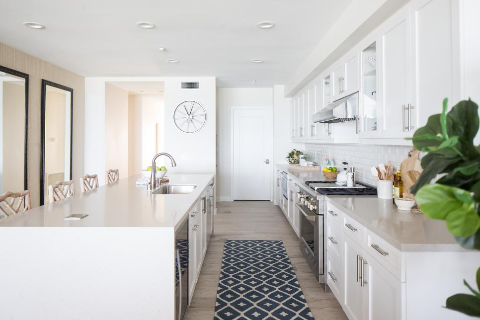 Contemporary Galley Kitchen With White Cabinets And Work Island