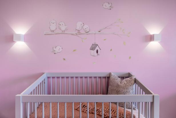 A calm nursery design with neutral color palette and artwork.