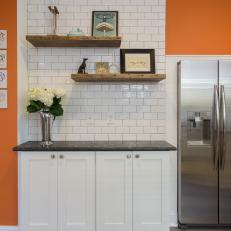Orange Kitchen Walls Surrounding White Subway Tile Backsplash and Reclaimed Wood Cabinetry