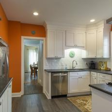 Bright Transitional Kitchen With Orange Accent Wall and Reclaimed Wood White Cabinets