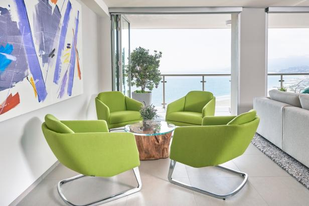 contemporary sitting area with green armchairs