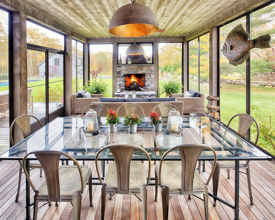 contemporary porch with dining set and fireplace