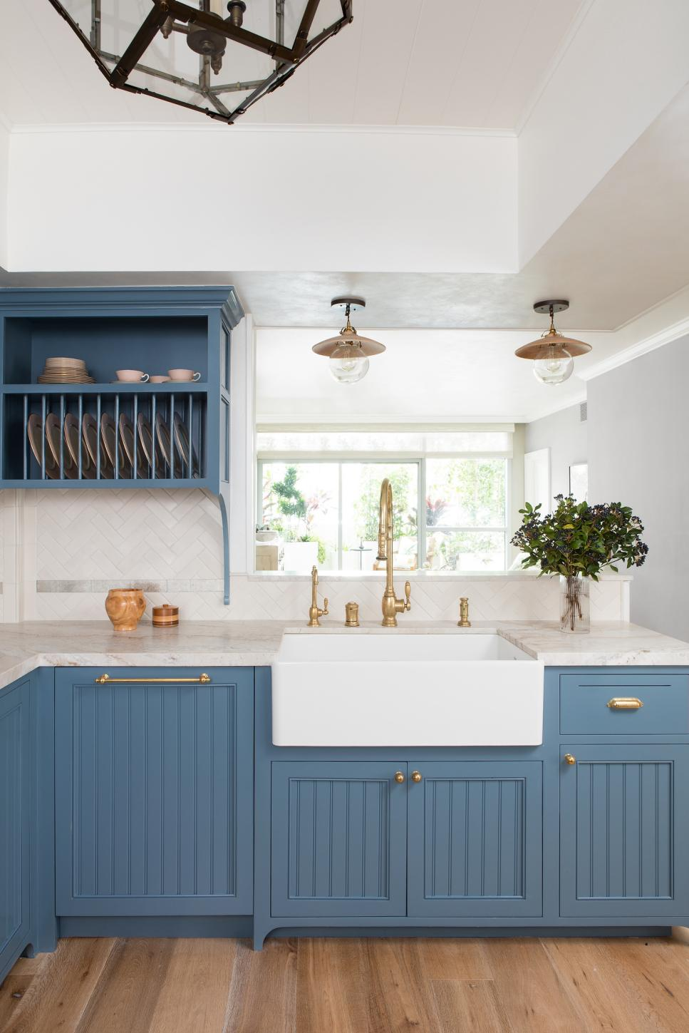 contemporary kitchen with blue cabinets