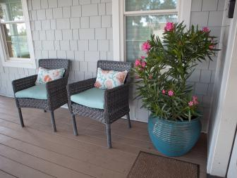 Porch With Gray Siding, Wicker Armchairs and Pink Oleander in Turquoise Pot