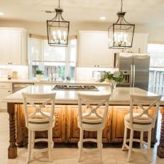 Traditional White Kitchen With Work Island And Seating