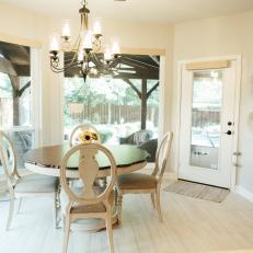 Traditional White Breakfast Nook With Round Table And Chandelier