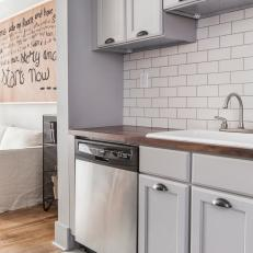 Gray Open Plan Kitchen With Subway Tile