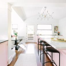 Pink Kitchen Island Complete With Chic Black Barstools