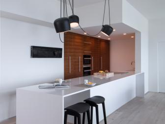 Modern Galley Kitchen With Work Island And Walnut Cabinets