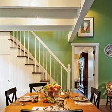 Green Dining Room With Fruit Bowl