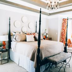 Contemporary Master Bedroom With Traditional Accents And Gold And Orange Highlights