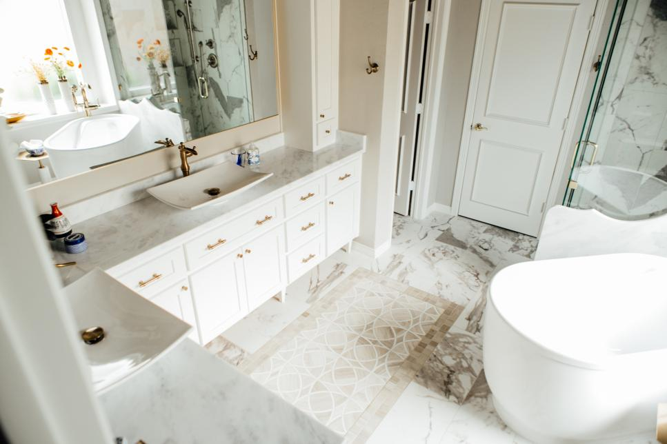 White And Neutral Marble Bathroom With Tub And Glass Shower