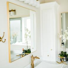 White Contemporary Master Bathroom Detail With Modern Bowl Sink And Gold Accents