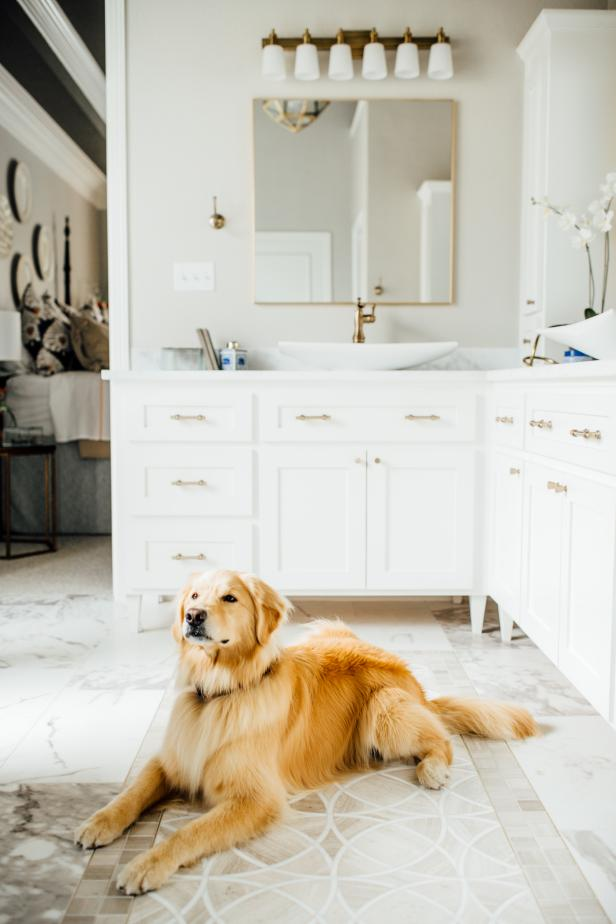 White Master Bathroom With Marble Tile Floor And Gold Accents